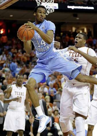North Carolina's Desmond Hubert (14) grabs a rebound in front of Texas' Cameron Ridley, right, during the first half of an NCAA college basketball game, Wednesday, Dec. 19, 2012, in Austin, Texas. (AP Photo/Eric Gay) Photo: Eric Gay, Associated Press / AP
