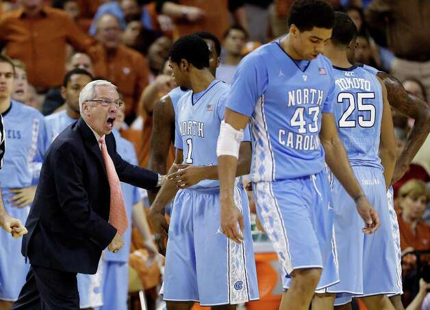 North Carolina head coach Roy Williams, left, yells at his players including Dexter Strickland (1), James Michael McAdoo (43) and J.P. Tokoto (25) during the second half of an NCAA college basketball game against Texas, Wednesday, Dec. 19, 2012, in Austin, Texas. Texas won 85-67. (AP Photo/Eric Gay) Photo: Eric Gay, Associated Press / AP