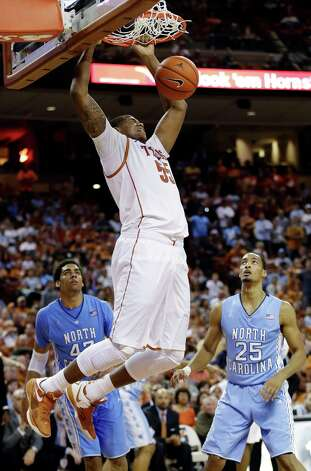 Texas' Cameron Ridley (55) drunks against North Carolina's James Michael McAdoo (43) and J.P. Tokoto (25) during the second half of an NCAA college basketball game, Wednesday, Dec. 19, 2012, in Austin, Texas. Texas won 85-67. (AP Photo/Eric Gay) Photo: Eric Gay, Associated Press / AP