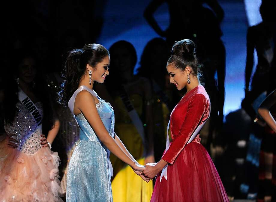 LAS VEGAS, NV - DECEMBER 19:  Miss Philippines 2012, Janine Tugonon (L), and Miss USA 2012, Olivia Culpo, wait for the judges' final decision during the 2012 Miss Universe Pageant at PH Live at Planet Hollywood Resort & Casino on December 19, 2012 in Las Vegas, Nevada. Culpo went on to be crowned the new Miss Universe and Tugonon was the first runner-up.  (Photo by David Becker/Getty Images) Photo: David Becker, Getty Images