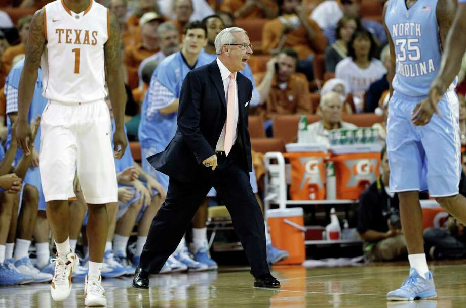 North Carolina head coach Roy Williams, center, yells to his players during the first half of an NCAA college basketball game against Texas, Wednesday, Dec. 19, 2012, in Austin, Texas. (AP Photo/Eric Gay) Photo: Eric Gay, Associated Press / AP