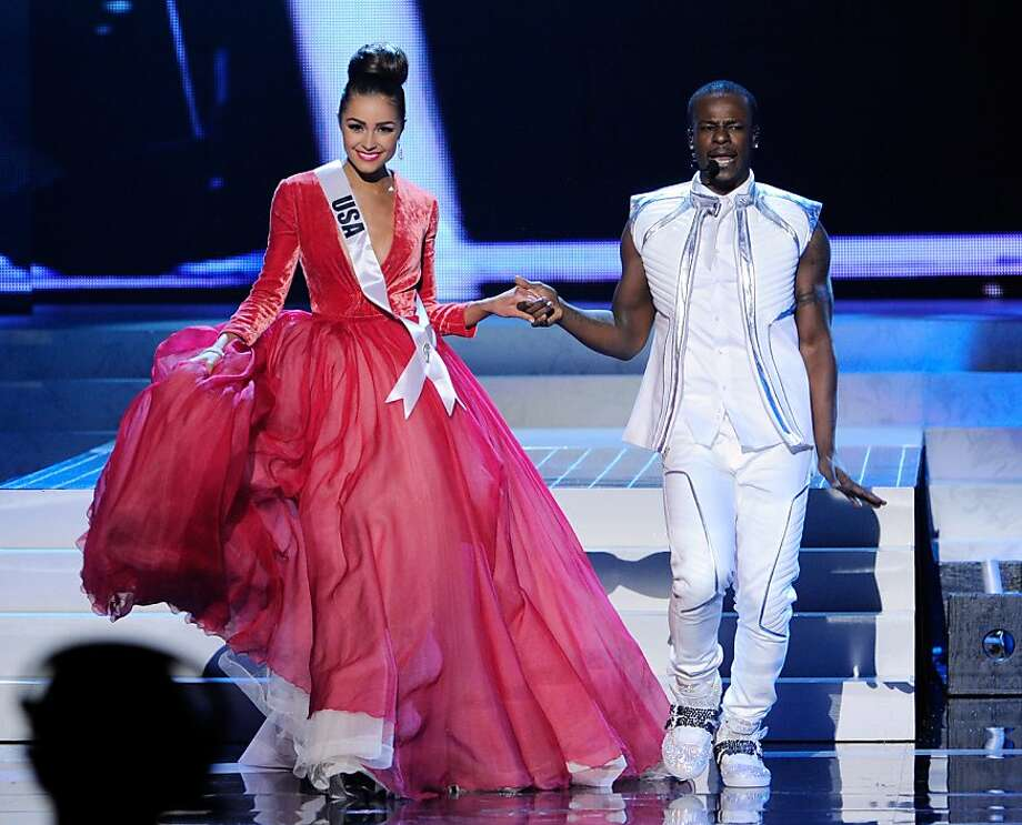 LAS VEGAS, NV - DECEMBER 19:  Miss USA 2012, Olivia Culpo (L), is escorted by singer/songwriter and dancer Timomatic during the 2012 Miss Universe Pageant at PH Live at Planet Hollywood Resort & Casino on December 19, 2012 in Las Vegas, Nevada. Culpo went on to be crowned the new Miss Universe.  (Photo by David Becker/Getty Images) Photo: David Becker, Getty Images