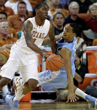 Texas' Sheldon McClellan, left, works the ball around North Carolina's J.P. Tokoto, right, during the first half of an NCAA college basketball game, Wednesday, Dec. 19, 2012, in Austin, Texas. (AP Photo/Eric Gay) Photo: Eric Gay, Associated Press / AP