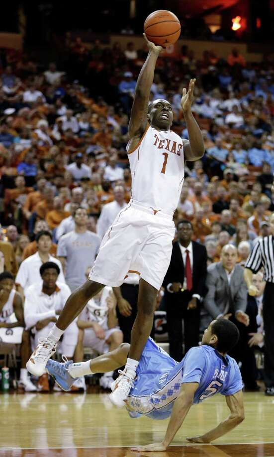 Texas' Sheldon McClellan (1) shoots over North Carolina's Marcus Paige, right, during the second half of an NCAA college basketball game, Wednesday, Dec. 19, 2012, in Austin, Texas. Texas won 85-67. (AP Photo/Eric Gay) Photo: Eric Gay, Associated Press / AP