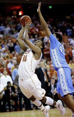 Texas' Jonathan Holmes (10) shoots past North Carolina's James Michael McAdoo (43) during the second half of an NCAA college basketball game, Wednesday, Dec. 19, 2012, in Austin, Texas. Texas won 85-67. (AP Photo/Eric Gay) Photo: Eric Gay, Associated Press / AP