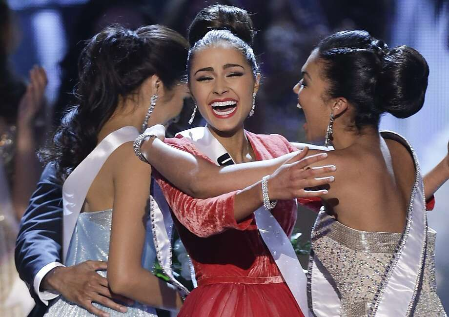 Miss USA, Olivia Culpo, center, reacts with Miss Teen USA, Logan West, as she is announced as the new Miss Universe over first runner-up Miss Philippines, Janine Tugonon, left, during the Miss Universe pageant, Wednesday, Dec. 19, 2012, in Las Vegas. (AP Photo/Julie Jacobson) Photo: Julie Jacobson, Associated Press
