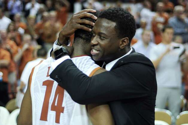 Texas guard Myck Kabongo, right, embraces Julien Lewis (14) after their 85-67 win over North Carolina in an NCAA college basketball game, Wednesday, Dec. 19, 2012, in Austin, Texas. Lewis scored 16 points in the victory. The NCAA is investigating Kabongo's relationship with an agent and Texas has given no indication when or if he'll return. Photo: Lawrence Peart, AP Photo/The Daily Texan / The Daily Texan