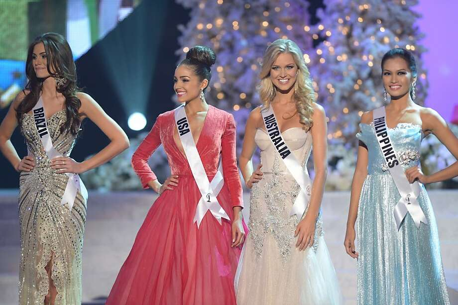 Miss Brazil, Gabriela Markus (L); Miss USA, Olivia Culpo (2nd-L); Miss Australia, Renae Ayris (2nd-R); and Miss Philippines, Janine Tugonon (R) stand on stage during the 2012 Miss Universe Pageant at Planet Hollywood in Las Vegas, Nevada on December 19, 2012.   Miss USA, Olivia Culpo was crowned Miss Universe 2012,  beating out beauties from around the world to claim the coveted title.  The title of first runner-up title went to the contestant from the Philippines, Janine Tugonon.  AFP PHOTO / JOE KLAMARJOE KLAMAR/AFP/Getty Images Photo: Joe Klamar, AFP/Getty Images