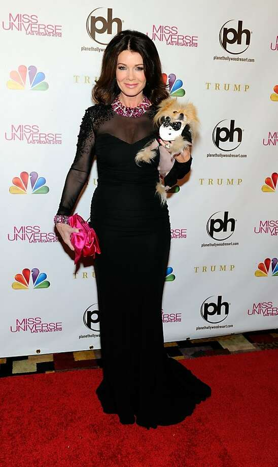 LAS VEGAS, NV - DECEMBER 19:  Television personality and pageant judge Lisa Vanderpump and her dog Giggy arrive at the 2012 Miss Universe Pageant at Planet Hollywood Resort & Casino on December 19, 2012 in Las Vegas, Nevada.  (Photo by David Becker/Getty Images) Photo: David Becker, Getty Images