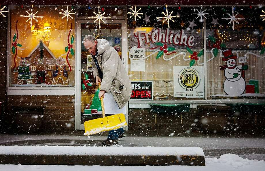 Don Hunter shovels outside of Gerda's German Restaurant and Bakery in Omaha Neb., Wednesday, Dec. 19, 2012. A storm that has dumped more than a foot of snow in the Rocky Mountains is heading east and is forecast to bring the first major winter storm of the season to the central plains and Midwest. (AP Photo/The World-Herald, Alyssa Schukar) MAGS OUT; ALL NEBRASKA LOCAL BROADCAST TV OUT Photo: Alyssa Schukar, Associated Press