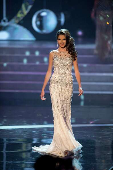 Miss France, Marie Payet, competes in an evening gown of her choice as one of the top 10 contestants