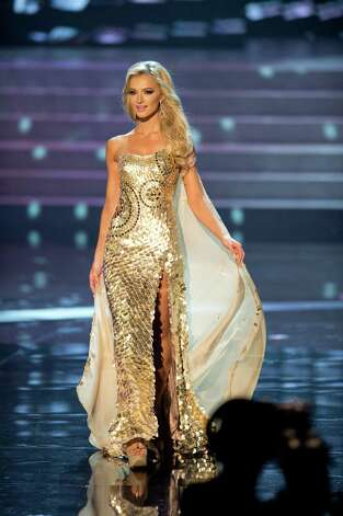 Miss South Africa, Melinda Bam, competes in an evening gown of her choice as one of the top 10 contestants. Photo: Matt Brown, Miss Universe Organization / Miss Universe Organization