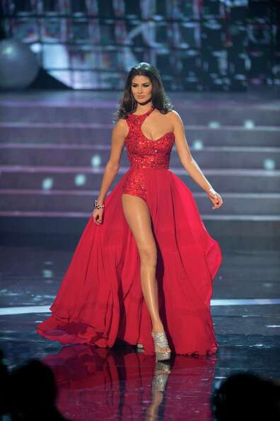 Miss Mexico, Karina Gonzalez, competes in an evening gown of her choice as one of the top 10 contest
