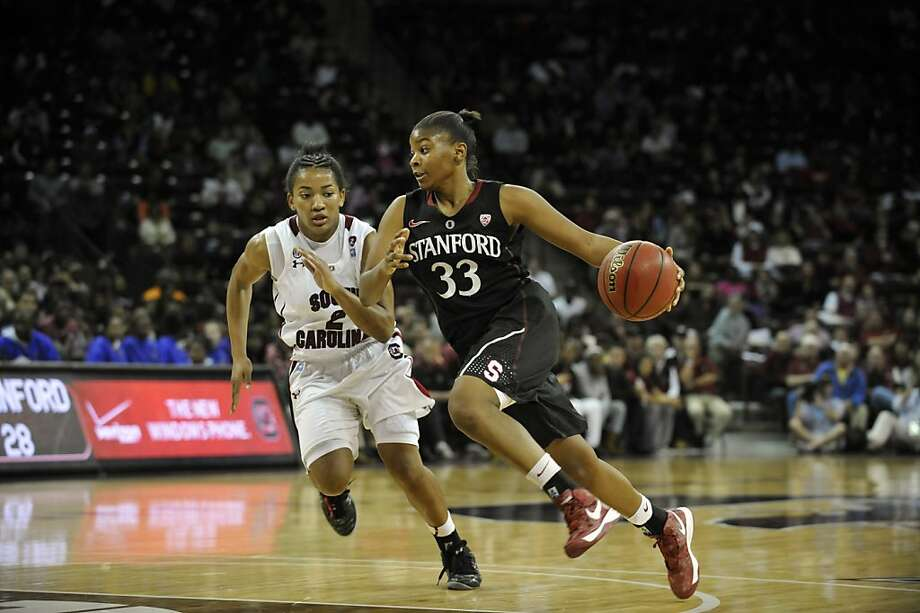 Stanford's Amber Orrange (33) drives as South Carolina's Ieasia Walker (2) defends during the second half of an NCAA college basketball game on Wednesday, Dec. 19, 2012, in Columbia, S.C. Stanford won 53-49. (AP Photo/Rainier Ehrhardt) Photo: Rainier Ehrhardt, Associated Press