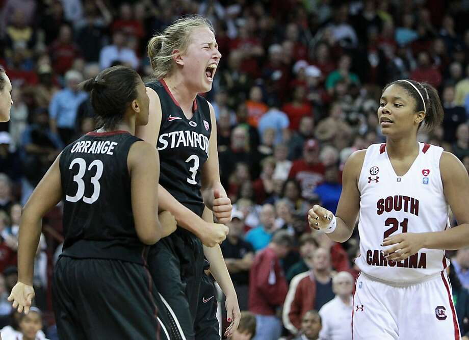 Stanford's Mikaela Ruef, center, celebrates drawing a foul against South Carolina at the Colonial Life Arena in Columbia, South Carolina, on Wednesday, December 19, 2012. (C. Aluka Berry/The State/MCT) Photo: C. Aluka Berry, McClatchy-Tribune News Service