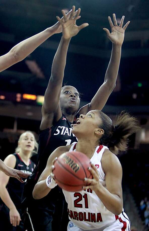 South Carolina's Ashley Bruner scores against Stanford's Chiney Ogwumike in the first period at the Colonial Life Arena in Columbia, South Carolina, on Wednesday, December 19, 2012. (C. Aluka Berry/The State/MCT) Photo: C. Aluka Berry, McClatchy-Tribune News Service