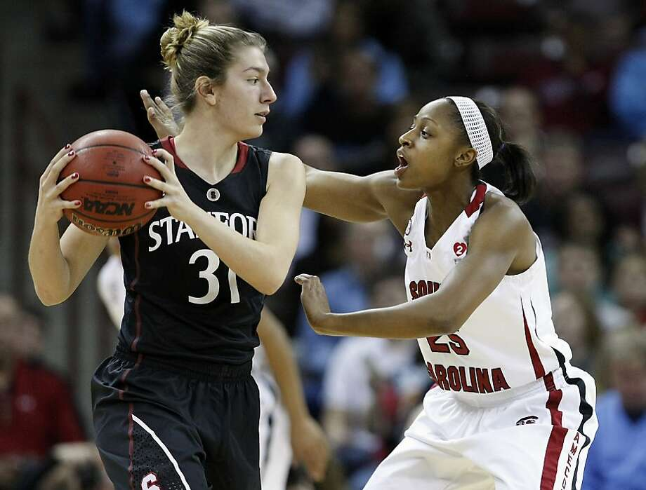 Stanford's Toni Kokenis is defended by South Carolina's Tiffany Mitchell in the first period at the Colonial Life Arena in Columbia, South Carolina, on Wednesday, December 19, 2012. (C. Aluka Berry/The State/MCT) Photo: C. Aluka Berry, McClatchy-Tribune News Service
