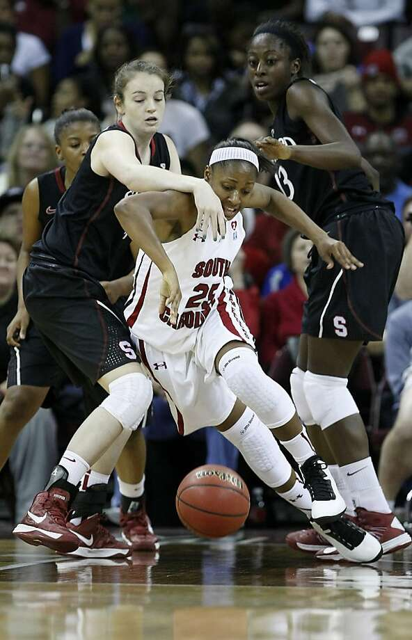 South Carolina's Tiffany Mitchell hustles for a loose ball against Stanford's Bonnie Samuelson, left, and Chiney Ogwumike in the first period at the Colonial Life Arena in Columbia, South Carolina, on Wednesday, December 19, 2012. (C. Aluka Berry/The State/MCT) Photo: C. Aluka Berry, McClatchy-Tribune News Service