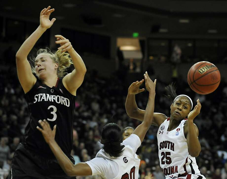 Stanford's Mikaela Ruef (3), South Carolina's Tiffany Mitchell (25) and teammate Sancheon White (20) go after a loose ball during the first half of an NCAA college basketball game on Wednesday, Dec. 19, 2012, in Columbia, S.C. Stanford won 53-49. (AP Photo/Rainier Ehrhardt) Photo: Rainier Ehrhardt, Associated Press