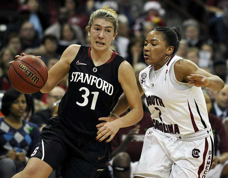 Stanford's Toni Kokenis (31) drives to the basket as South Carolina's Ieasia Walker (2) defends during the first half of an NCAA college basketball game on Wednesday, Dec. 19, 2012, in Columbia, S.C. (AP Photo/Rainier Ehrhardt) Photo: Rainier Ehrhardt, Associated Press