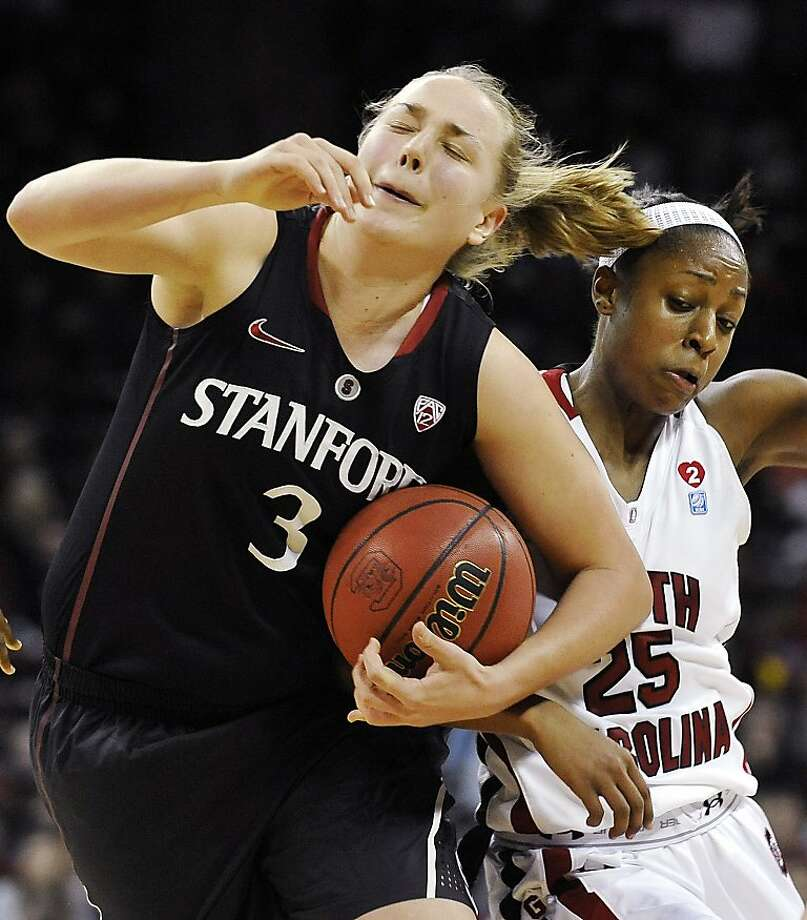 Stanford's Mikaela Ruef (3) is fouled by South Carolina's Tiffany Mitchell (25) during the second half of an NCAA college basketball game, Wednesday, Dec. 19, 2012, in Columbia, S.C. Stanford won 53-49. (AP Photo/Rainier Ehrhardt) Photo: Rainier Ehrhardt, Associated Press
