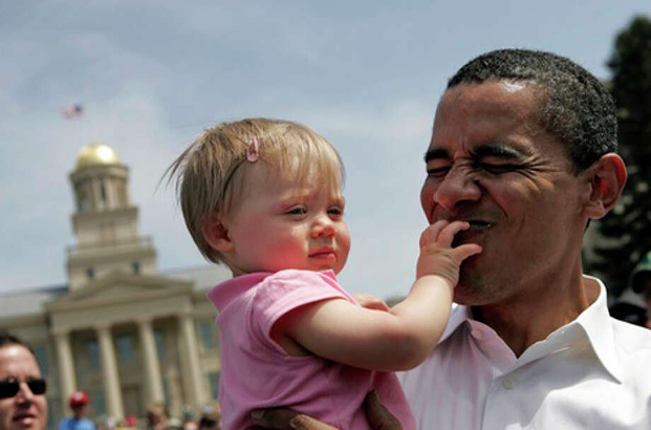 Democratic presidential hopeful Senator Barack Obama (D-IL) holds 10-month-old Claire Von Bergen of Iowa City while shaking hands with supporters after speaking on the Pentacrest at the University of Iowa April 22, 2007 in Iowa City, Iowa. The Senator spoke as part of an Earth Day celebration on the campus. Photo: Scott Morgan, Getty Images / 2007 Getty Images