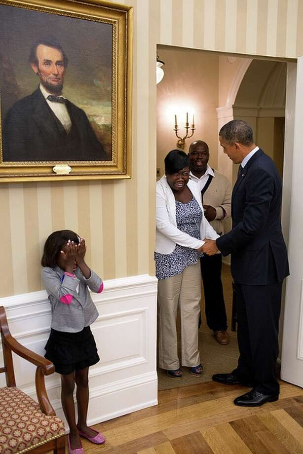 Eight-year old Make-A-Wish child Janiya Penny reacts after meeting President Barack Obama as he welcomes her family to the Oval Office, Aug. 8, 2012. (Pete Souza / White House)