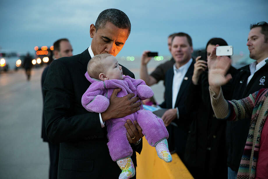 President Barack Obama kisses a baby on the tarmac following his arrival at Denver International Airport in Denver, Colo., Nov. 1, 2012. (Pete Souza  / White House)