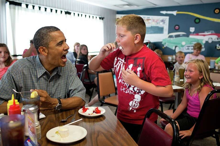 President Barack Obama shares his strawberry pie with a boy during a lunch stop at Kozy Corners restaurant in Oak Harbor, Ohio, July 5, 2012.  (Pete Souza / White House)