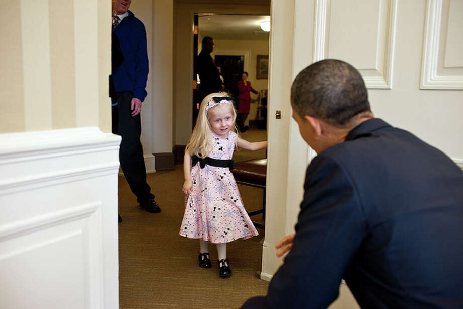President Barack Obama welcomes Make-A-Wish child Kennedy Alexander to the Oval Office, March 15, 2011. (Official White House Photo by Pete Souza)This official White House photograph is being made available only for publication by news organizations and/or for personal use printing by the subject(s) of the photograph. The photograph may not be manipulated in any way and may not be used in commercial or political materials, advertisements, emails, products, promotions that in any way suggests approval or endorsement of the President, the First Family, or the White House. Photo: Pete Souza, The White House / This photograph is provided by THE WHITE HOUSE as a courtesy and may be printed by the subject(s) in the photograph for personal