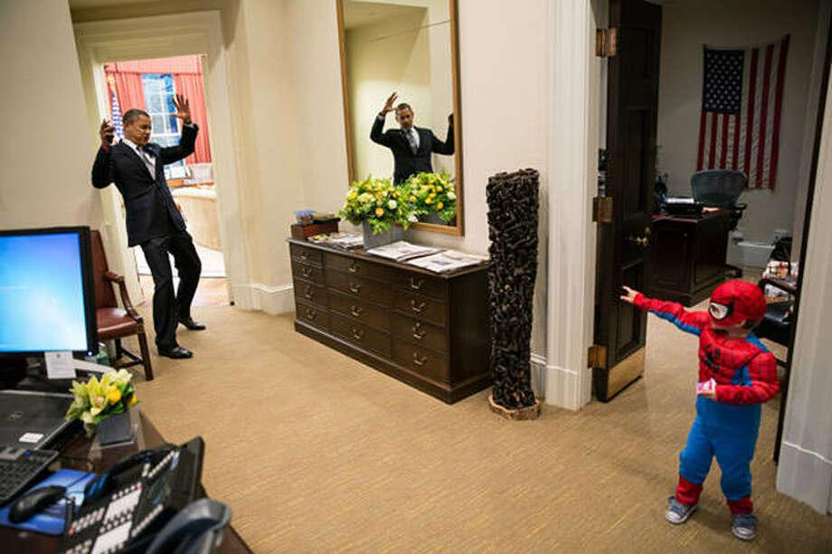 President Barack Obama pretends to be caught in Spider-Man's web as he greets the son of a White House staffer in the Outer Oval Office, Oct. 26, 2012. (Pete Souza / The White House)