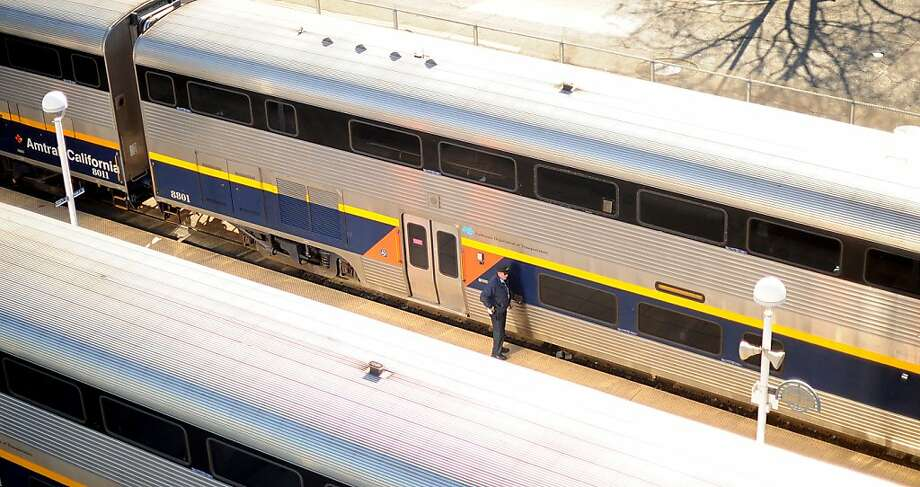 In this file photo, a conductor prepares an Amtrak train for departure from Jack London Square in Oakland. A person was fatally hit by an Amtrak Train about three miles  south of the Jack London station on Sunday evening. Photo: Noah Berger, Special To The Chronicle