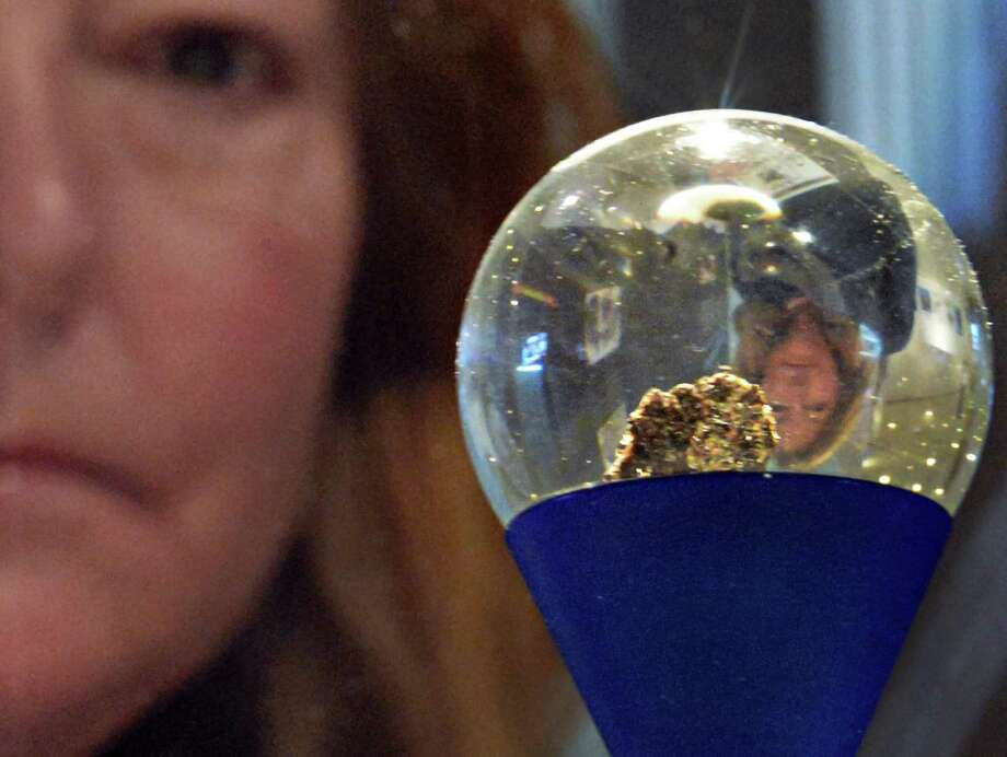 Victoria Schmitt of Rochester looks at New York?s Goodwill moon rock from the Apollo 17 mission on exhibit at the New York State Museum in Albany Wednesday Dec. 19, 2012. (John Carl D'Annibale / Times Union) Photo: John Carl D'Annibale / 00020500A