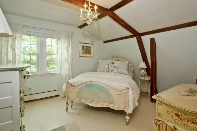 Exposed beams accentuate the clean look of this elegant bedroom. Photo: Rob Staub, Contributed Photo/Rob Staub / WWW.RobStaubphoto.com