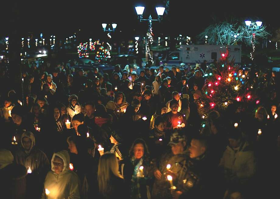 "Many hundreds of area residents share a ""Peace be with you""greeting Sunday as they bond on the Village Green in New Milford during a vigil dedicated to those who died and those who mourn their deaths in Newtown. Photo: Trish Haldin"