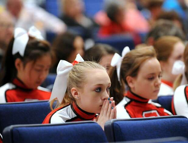 Greenwich High School cheerleader Dakota Hirsch, 14, a freshman, during the community vigil in memory of the victims of the Sandy Hook Elementary School shooting in Newtown, at Greenwich High School, Tuesday night, Dec. 18, 2012. Photo: Bob Luckey