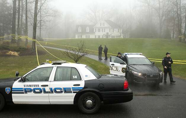 Stamford and Westport police outside the home of Nancy Lanza  December 18, 2012 in Newtown, Connecticut.  Nancy Lanza was killed by her son Adam before going on his rampage at Sandy Hook Elementary School on December 14, 2012. AFP PHOTO/DON EMMERT        (Photo credit should read DON EMMERT/AFP/Getty Images) Photo: Don Emmert, AFP/Getty Images