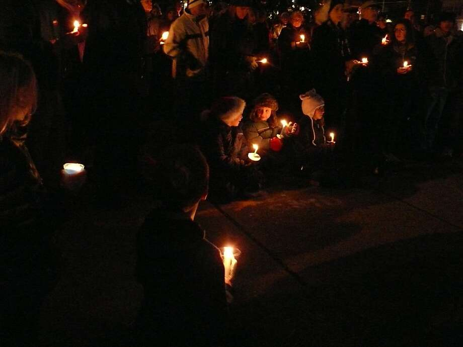 Several hundred people gathered on Sherman Green Monday for a vigil for the victims of the school shooting in Newtown. Photo: Genevieve Reilly