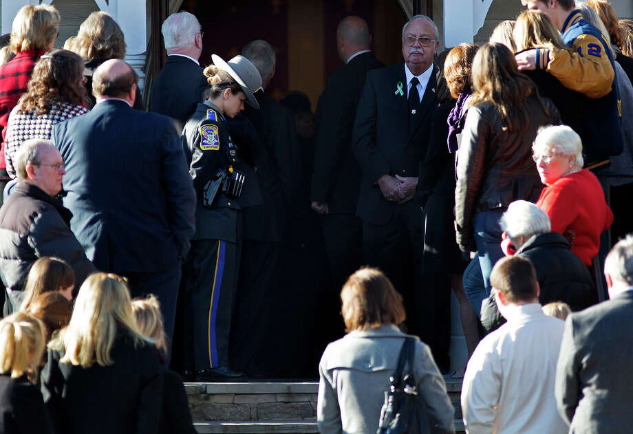 A Connecticut State Police officer bows her head as the funeral service for teacher Anne Marie Murphy at the St. Mary Of The Assumption Church in Katonah, N.Y. Thursday, Dec. 20, 2012. Murphy was killed when gunman, Adam Lanza, walked into Sandy Hook Elementary School in Newtown, Conn., Dec. 14, and opened fire, killing 26, including 20 children, before killing himself. Photo: AP