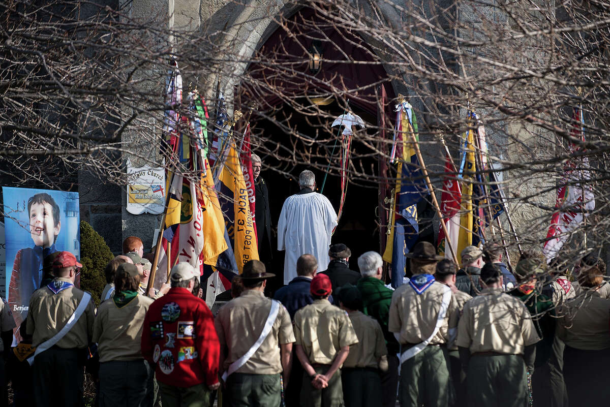 Area Boy Scouts and others wait outside for the funeral of Benjamin Wheeler at Trinity Episcopal Church December 20, 2012 in Newtown, Connecticut. Benjamin Wheeler, age 6, is one of the victims from last Friday's shooting at Sandy Hook Elementary School which took the lives of 20 students and 6 adults. AFP PHOTO/Brendan SMIALOWSKI