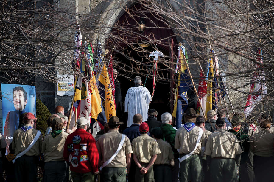 Area Boy Scouts and others wait outside for the funeral of Benjamin Wheeler at Trinity Episcopal Church December 20, 2012 in Newtown, Connecticut. Benjamin Wheeler, age 6, is one of the victims from last Friday's shooting at Sandy Hook Elementary School which took the lives of 20 students and 6 adults.  AFP PHOTO/Brendan SMIALOWSKI Photo: BRENDAN SMIALOWSKI, AFP/Getty Images / 2012 AFP