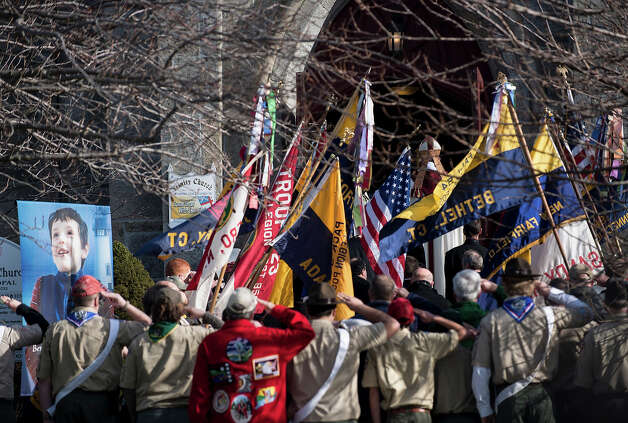 Area Boy Scouts salute as the casket with Benjamin Wheeler's is carried into Trinity Episcopal Church for his funeral December 20, 2012 in Newtown, Connecticut. Benjamin Wheeler, age 6, is one of the victims from last Friday's shooting at Sandy Hook Elementary School which took the lives of 20 students and 6 adults.  AFP PHOTO/Brendan SMIALOWSKI Photo: BRENDAN SMIALOWSKI, AFP/Getty Images / 2012 AFP