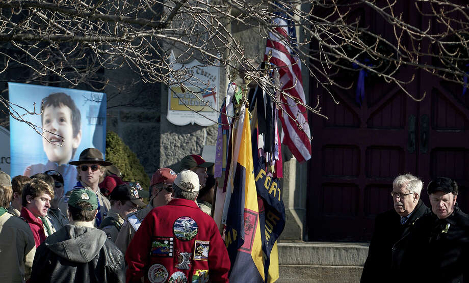 Mourners wait outside for the funeral of Benjamin Wheeler at Trinity Episcopal Church December 20, 2012 in Newtown, Connecticut. Benjamin Wheeler, age 6, is one of the victims from last Friday's shooting at Sandy Hook Elementary School which took the lives of 20 students and 6 adults.  AFP PHOTO/Brendan SMIALOWSKI Photo: BRENDAN SMIALOWSKI, AFP/Getty Images / 2012 AFP