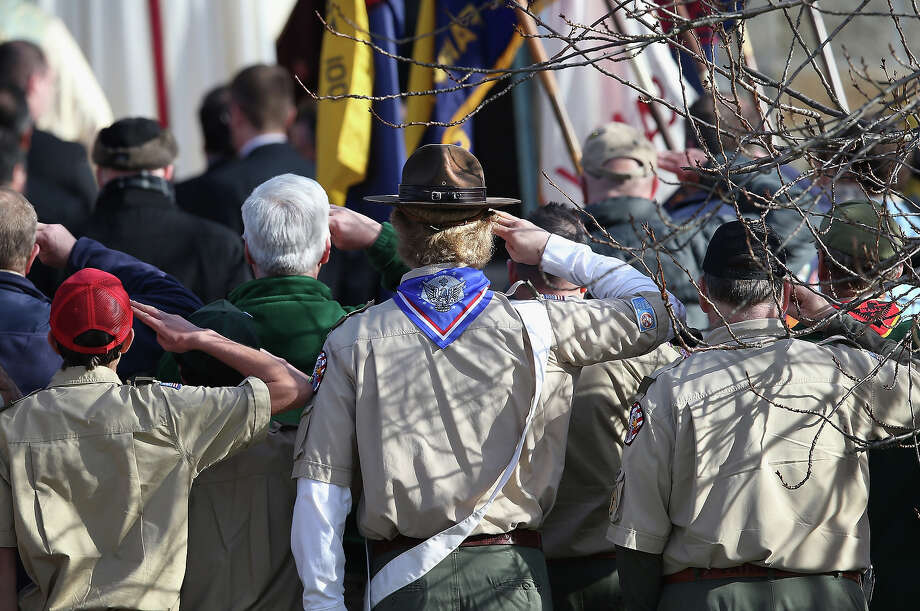 NEWTOWN, CT - DECEMBER 20:  Boy scouts salute as a funeral procession for Benjamin Wheeler, 6, enters the Trinity Episcopal Church on December 20, 2012 in Newtown, Connecticut. Benjamin, a member of Tiger Scout Den 6, was killed when 20 children and six adults were massacred at Sandy Hook Elementary School last Friday. Photo: John Moore, Getty Images / 2012 Getty Images