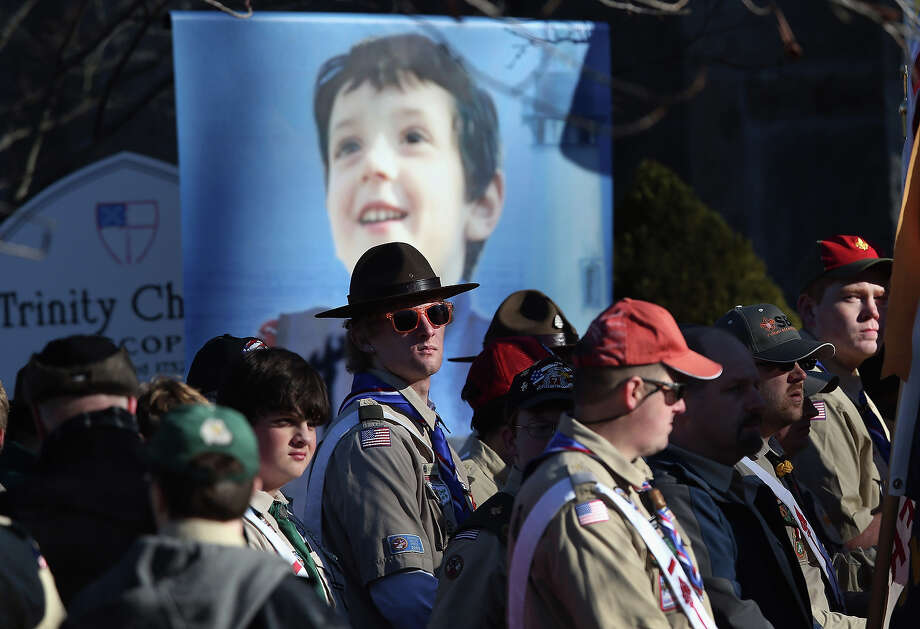 NEWTOWN, CT - DECEMBER 20:  Boy scouts await a funeral procession for Benjamin Wheeler, 6, (in photo), at the Trinity Episcopal Church on December 20, 2012 in Newtown, Connecticut. Benjamin, a member of Tiger Scout Den 6, was killed when 20 children and six adults were massacred at Sandy Hook Elementary School last Friday. Photo: John Moore, Getty Images / 2012 Getty Images