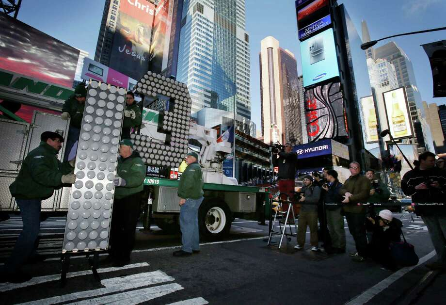 "Workers unload the number ""13"" to be used during the New Year's Eve celebration in Times Square in New York, Wednesday, Dec. 19, 2012. Photo: Seth Wenig, AP / AP"