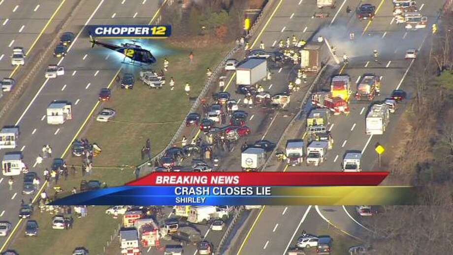 This image taken from video on the News 12 Long Island website shows an aerial view of a multi-vehicle accident on the Long Island Expressway, Wednesday, Dec. 19, 2012, in Shirley, N.Y. Police have closed the Expressway between exits 65 and 69 so first responders can work the scene. Over 20 vehicles are believed to be involved. (AP Photo/News 12 Long Island) MANDATORY CREDIT: NEWS 12 LONG ISLAND Photo: AP / News 12 Long Island