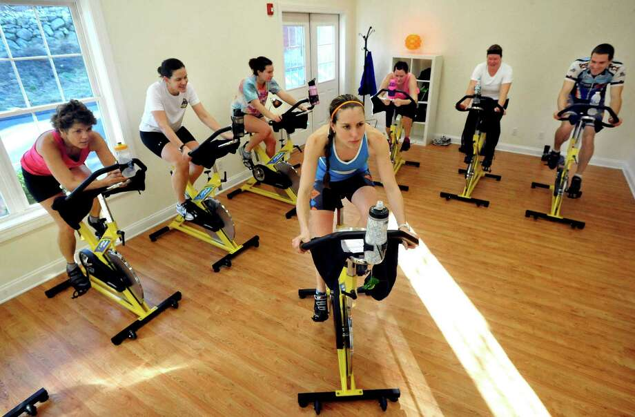 Natalie Staszak leads 6-Pack Cycle Class at Sun Angel Fitness in New Fairfield Thursday, Dec. 20, 2012. Photo: Michael Duffy / The News-Times