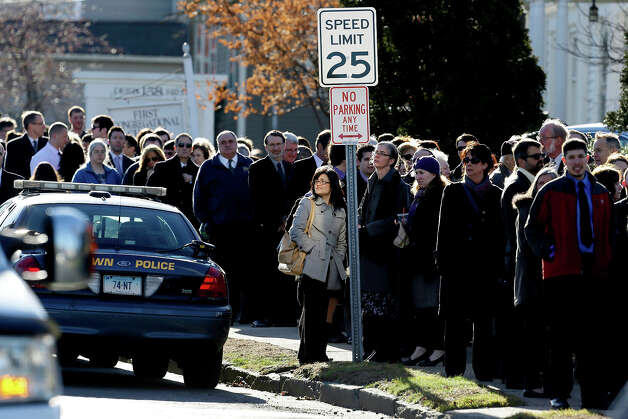 People wait in line to enter a church before a memorial service for Lauren Rousseau in Danbury, Conn., Thursday, Dec. 20, 2012.   Rousseau, 30, was killed when Adam Lanza walked into Sandy Hook Elementary School in Newtown, Dec. 14, and opened fire, killing 26 people, including 20 children, before killing himself. Photo: AP