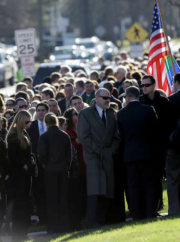 A long line stretches down the block in front of the First Congregational Church before a memorial service for Lauren Rousseau in Danbury, Conn., Thursday, Dec. 20, 2012.   Rousseau, 30, was killed when Adam Lanza walked into Sandy Hook Elementary School in Newtown, Dec. 14, and opened fire, killing 26 people, including 20 children, before killing himself. Photo: AP